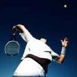 tennis player serving overhead