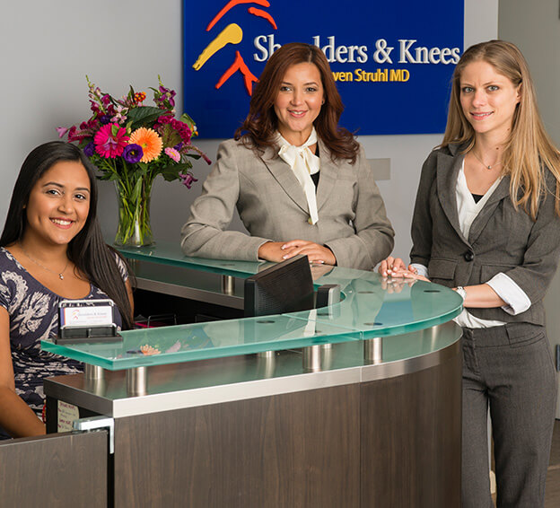 staff at the front desk at Shoulder and Knees surgery office
